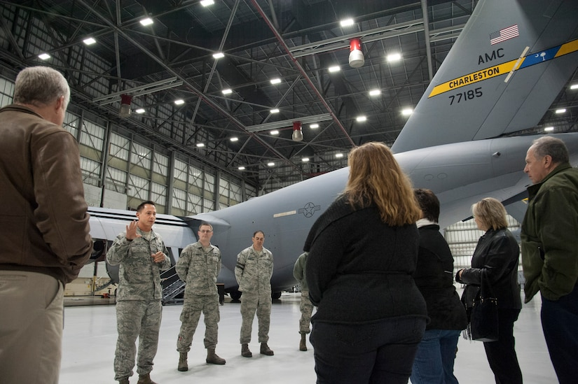 JOINT BASE CHARLESTON, S.C. – Tech. Sgt. Nolan Gibson, 437th Maintenance Squadron Home Station Check dock chief and coordinator, briefs a group of community leaders during an evening tour at Joint Base Charleston, S.C., Feb. 11, 2015. The tour exposed the leaders to the important contributions of Charleston's Nighttime Warriors. Gibson explained the process for providing in-depth home station checks for every C-17 Globemaster III in the base's inventory—a process each plane must undergo every 120 days. (U.S. Air Force Photo/Capt. Christopher Love)