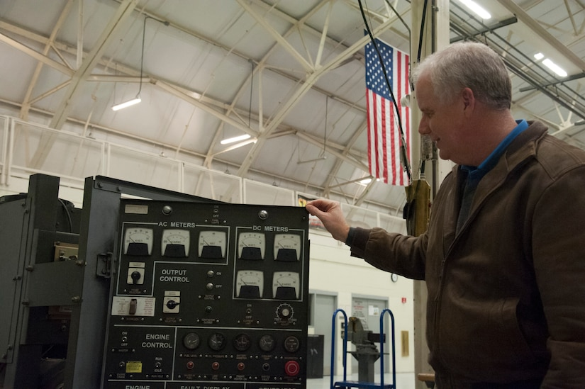 JOINT BASE CHARLESTON, S.C. – Marc Tye, Joint Base Charleston Advisory Council member, examines an ESSEX Generator during a tour for community leaders Feb. 11, 2015 at Joint Base Charleston, S.C. The tour exposed the leaders to the important contributions of Charleston's Nighttime Warriors. (U.S. Air Force Photo/Capt. Christopher Love)