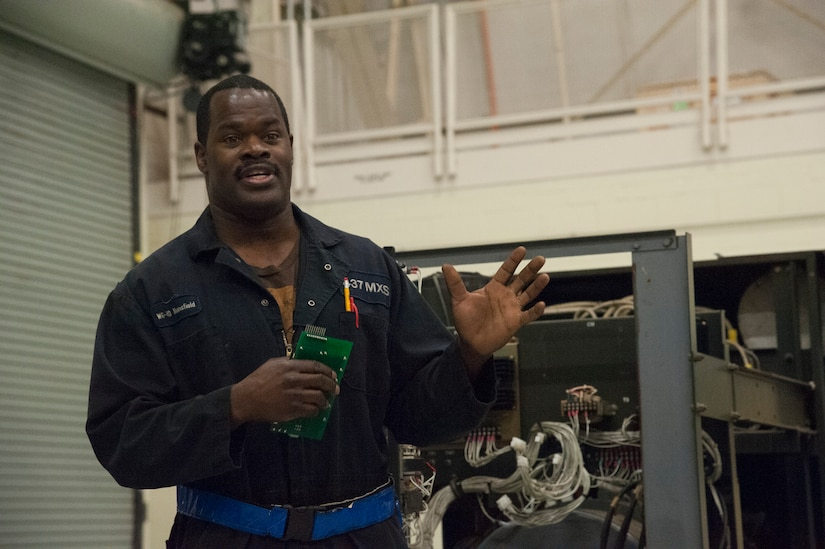 JOINT BASE CHARLESTON, S.C. – Paul Mansfield, 437th Maintenance Squadron Aerospace Ground Equipment technician, briefs community leaders about his role in maintaining an ESSEX Generator at Joint Base Charleston, S.C., Feb. 11, 2015. The tour exposed the leaders to the important contributions of Charleston's Nighttime Warriors. Mansfield, a former service member, has filled a civilian position at Joint Base Charleston since 1986 and has worked night shift since 2007. (U.S. Air Force Photo/Capt. Christopher Love)