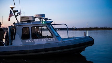A 628th Security Forces Squadron patrol boat sits idle Feb. 11, 2015, at Dock Charlie on Joint Base Charleston – Weapons Station, S.C. The Defenders patrol miles of shoreline using their high-speed, high-maneuverability boats, both day and night. (U.S. Air Force photo/Airman 1st Class Clayton Cupit)