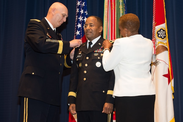 Army Chief of Staff Gen. Ray Odierno and Monique Ferrell pin three-star rank on Army Lt. Gen. Robert S. Ferrell during a Jan. 24, 2014, promotion ceremony at Fort Lesley J. McNair in Washington, D.C. U.S. Army photo by Staff Sgt. Steve Cortez