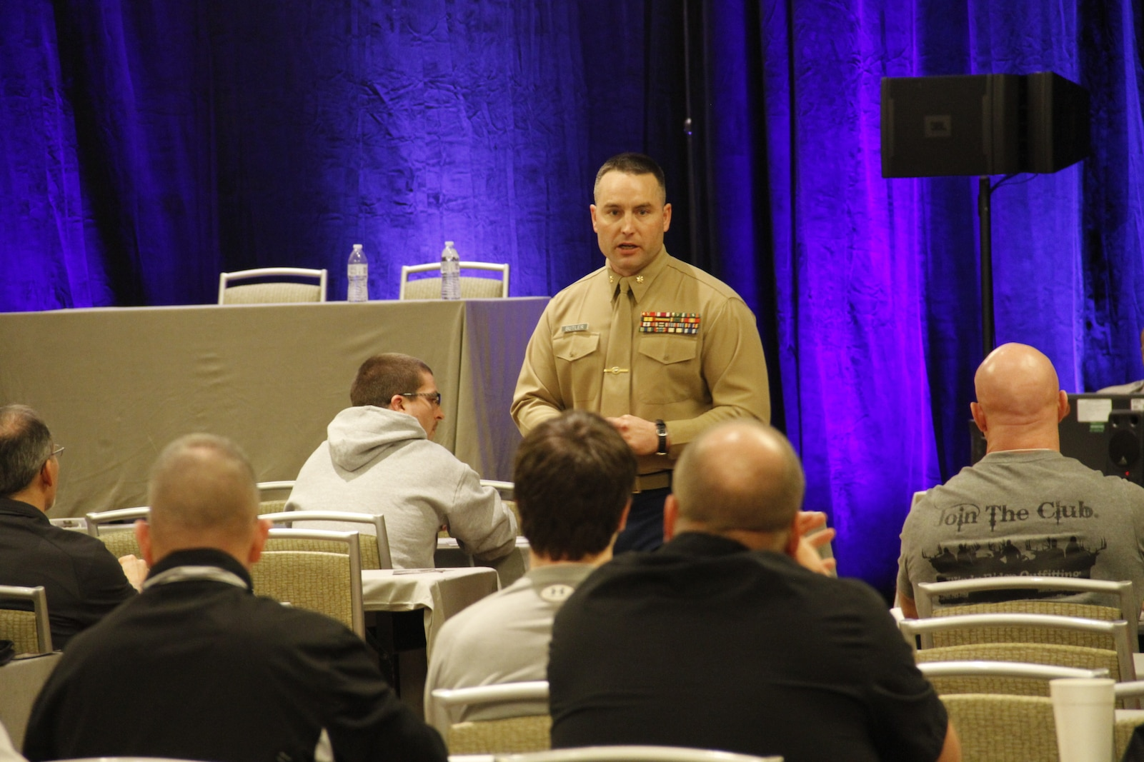 Major Alfred L. Butler, IV, Marine Corps Recruiting Station Kansas City commanding officer, addresses coaches on ways to instill leadership during the 2015 Glazier Clinics at the Westin Crown Center Feb. 6, 2015. Butler related how his experiences as an infantry officer and leading Marines and how many of the same principles he employed may help to foster teamwork and leadership amongst coaches' players.