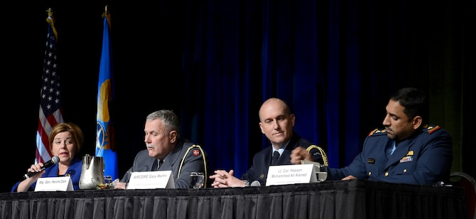 Heidi Grant moderates a panel discussion during the Air Force Association's annual Air Warfare Symposium and Technology Exposition Feb. 12, 2015, in Orlando, Fla. The panel included Maj. Gen. Henrik Dam, from the Royal Danish air force; Air Commodore Gary Martin, from the Royal Australian air force; and Lt. Col. Hassan Mohammed Ali Alanazi, from the United Arab Emirates air force. Grant is the deputy under secretary of the Air Force, International Affairs. (U.S. Air Force photo/Scott M. Ash)
