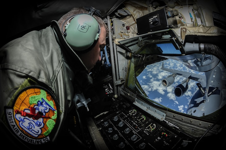 Senior Master Sgt. Walt Markwas, 91st Air Refueling Squadron boom operator, focuses on controlling the boom of a KC-135 Stratotanker in order to refuel a C-17 Globemaster during a pilot training mission off the coast of North Carolina, Feb. 3, 2015. The C-17 crew was accomplishing refuel contact qualifications. (U.S. Air Force photo by Senior Airman Vernon L. Fowler Jr./Released)
