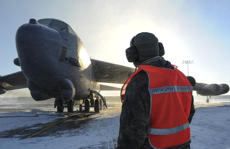 Airman 1st Class Yousef Sakhnini observes the engines of a B-52H Stratofortress before takeoff Feb. 4, 2015, on Minot Air Force Base, N.D. Sakhnini is a 5th Aircraft Maintenance Squadron crew chief.  His job requires him to be in constant communication with aircrew to ensure any discrepancies are identified and fixed before flight. (U.S. Air Force photo/Senior Airman Stephanie Morris)