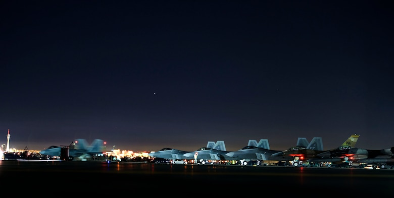 An F-22 Raptor taxis toward the runway prior to flying a Red Flag 15-1 training mission Feb. 4, 2015, at Nellis Air Force Base, Nev. Night missions have been integrated into Red Flag to prepare aircrews for missions in low-light environments. The F-22 is assigned to the 94th Fighter Squadron at Joint Base Langley-Eustis, Va. (U.S. Air Force photo/Airman 1st Class Mikaley Towle)