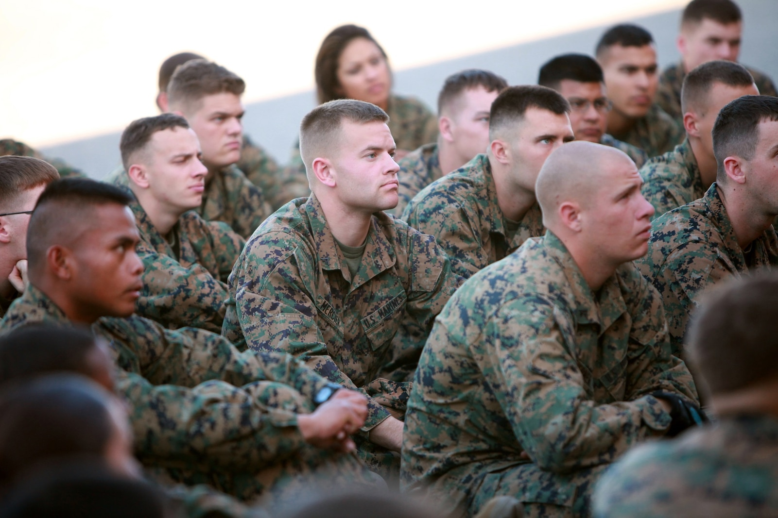 Junior Marines with General Support Motor Transport, Combat Logistics Regiment 1, 1st Marine Logistics Group, listen as Sgt. Maj. Juan Diaz, seargeant major of CLR-1, 1st MLG, gives a brief at the GSMT lot at Camp Pendleton, Calif., March 8. Since he assumed his post as sergeant major of CRL-1, 1st MLG, here, Jan. 21, Diaz wasted no time making sure his Marines understand what he expects as it pertains to discipline, conduct, standards and morale.