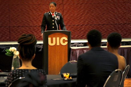 "Maj. Shanelle Porter gives a speech during the Black Student Union Heritage Ball at the University of Illinois Chicago, Feb. 12. Porter is the commanding officer of Recruiting Station Chicago. She was chosen to be the guest of honor because of her illustrious past, and her promising future. During her speech, she advocated doing away with being ""the first black person"" to do something, because it'll soon all be done. ""I believe that if we all are willing to scale a jungle gym and not a ladder, have the will, the audacity and the courage to lead, and believe that when you arrive, you are supposed to be there, we will be great leaders and we will be excellent,"" said Porter, who is the first black woman in Marine Corps history to command a recruiting station. ""This is how we will move closer to there being no more firsts to achieve."""