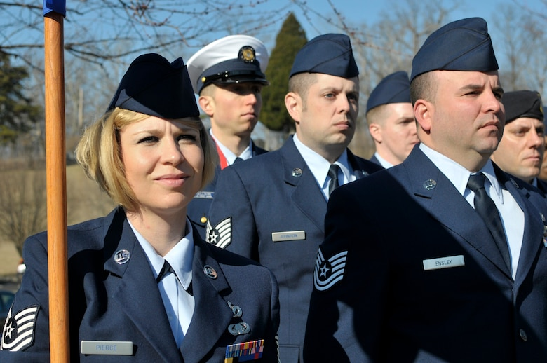 MCGHEE TYSON AIR NATIONAL GUARD BASE, Tenn. - Tech. Sgt. Abby Pierce, from the 139th Airlfit Wing, Missouri Air National Guard, holds the guidon for J-flight, during the graduation day retreat ceremony for NCO Academy and Airman Leadership School here, Feb. 12, 2015, at the I.G. Brown Training and Education Center. Pierce and Tech. Sgt. Gershon Raposo voluntered to sing the National Anthem for their class's ceremony. (U.S. Air National Guard photo by Master Sgt. Mike R. Smith/Released)
