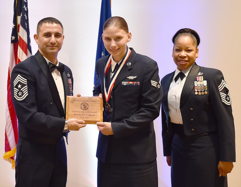 Senior Airman Amber N. Powell, member of the 460th Operations Support Squadron, receives the Academic Achievement Award during the Buckley Airman Leadership School Class 15-B graduation Feb. 12, 2015, at the Leadership Development Center on Buckley Air Force Base, Colo. This award is presented to the student with the highest overall average on all academic evaluations during ALS. (U.S. Air Force photo by Airman 1st Class Luke Nowakowski/Released)