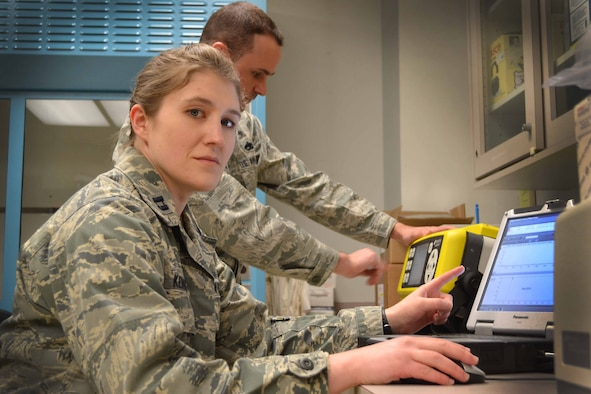 Capt. Jessica Kenney, 111th Attack Wing bioenvironmental engineer, conducts operations at her workstation with the assistance of Tech. Sgt. Joseph Runewicz, 111th ATKW, Feb. 12, 2015, Horsham Air Guard Station, Pa.  Bioenviornmental engineering technicians focus on supporting all aspects of the wing's mission such as: flight operations, maintenance, aerial port, logistics, vehicle maintenance, civil engineering and services. (U.S. Air National Guard Photo by Master Sgt. Christopher Botzum/Released)