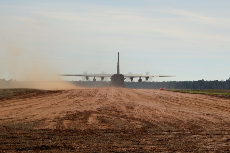 A C-130H Hercules aircraft assigned to the 103rd Airlift Wing prepares to take off from Ramagen dirt strip, Bryon County, Ga., Jan. 7, 2015. The aircraft was piloted by Lt. Col. Steve Gwinn and Maj. Josh Panis; both were qualifying for a special certification that permits them to land on short, unimproved runways. (U.S. Air National Guard photo by Senior Air-man Emmanuel Santiago)