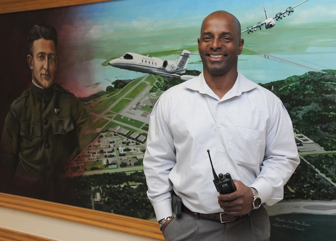 """Al Watkins, 81st Infrastructure Division chief of operations, poses for a photo at an Air Show meeting Feb. 11, 2015, at the Sablich Center, Keesler Air Force Base, Miss. Watkins also serves as the ground operations assistant director for the Keesler Air Show/Open House March 28-29. The retired Air Force master sergeant is responsible for setup of """"everything except the planes,"""" including barricades, foreign object debris fencing, utility setup, trash receptacles, tents, water buffaloes and other on-the-ground requirements. He is the liaison with the contractors on base responsible for many of the services involved in staging the show. (U.S. Air Force photo by Kemberly Groue)"""