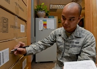 "Senior Airman Robert Ocampo, 28th Contracting Squadron contract administrator, conducts product inventory at the 28th CONS office at Ellsworth Air Force Base, S.D., Jan. 22, 2015. For fiscal year 2014, the 28th CONS completed 500 contracting actions valued at over $32 million and was recognized as Air Combat Command's ""2014 Air Force Productivity Excellence Award"" nominee. (U.S. Air Force photo by Senior Airman Anania Tekurio/Released)"