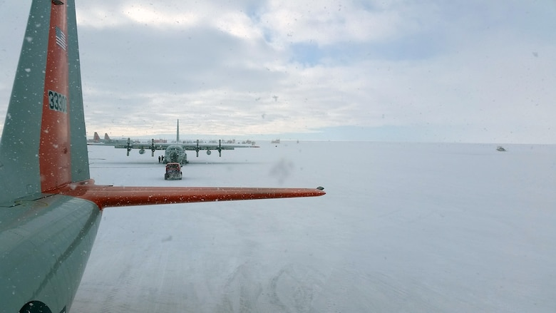 A C-130 Hercules aircraft sits at McMurdo Station, Antarctica, during a snow storm Nov. 13, 2014. Senior Airman Lucas McEntire, an aircraft fuels systems mechanic with the 103rd Mainte-nance Squadron, said he took the photo from on top of one of the C-130 aircraft that he was working on. (U.S. Air National Guard photo courtesy of Senior Airman Lucas McEntire)