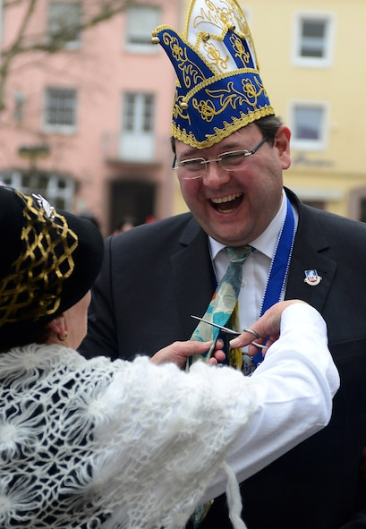 Joachim Kandels, Bitburg mayor, gets his tie cut off during the 2015 Storming of the Rathaus Fasching event in Bitburg, Germany, Feb. 12, 2015. A woman cutting off a man's tie is a longtime tradition observed during Fasching. (U.S. Air Force photo by Airman 1st Class Luke Kitterman/Released)
