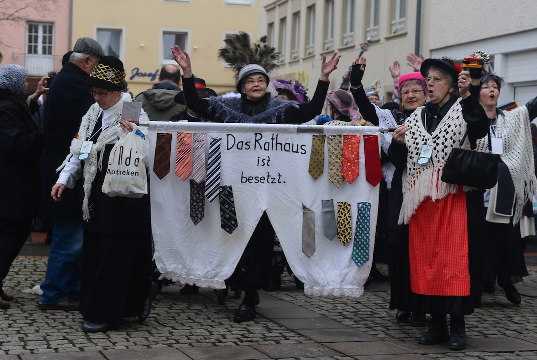 Female citizens of Bitburg, Germany, march into the city square during the 2015 Storming of the Rathaus Fasching event in Bitburg, Germany, Feb. 12, 2015. More than 250 people participated in the city's Fasching celebration. (U.S. Air Force photo by Airman 1st Class Luke Kitterman/Released)