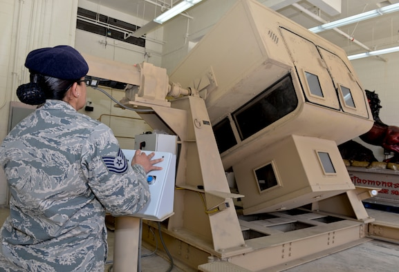 Brig. Gen. Andrew Toth, 36th Wing commander and Chief Master Sgt. Michael McMillan, 36th Wing command chief, participate in Humvee rollover simulator training during an immersion tour Feb. 12, 2015, at Andersen Air Force Base, Guam. Toth and McMillan got a closer look at the capabilities the Guam Air National Guard brings to the island and the mission at Andersen AFB.  (U.S. Air Force photo by Staff Sgt. Robert Hicks/Released)
