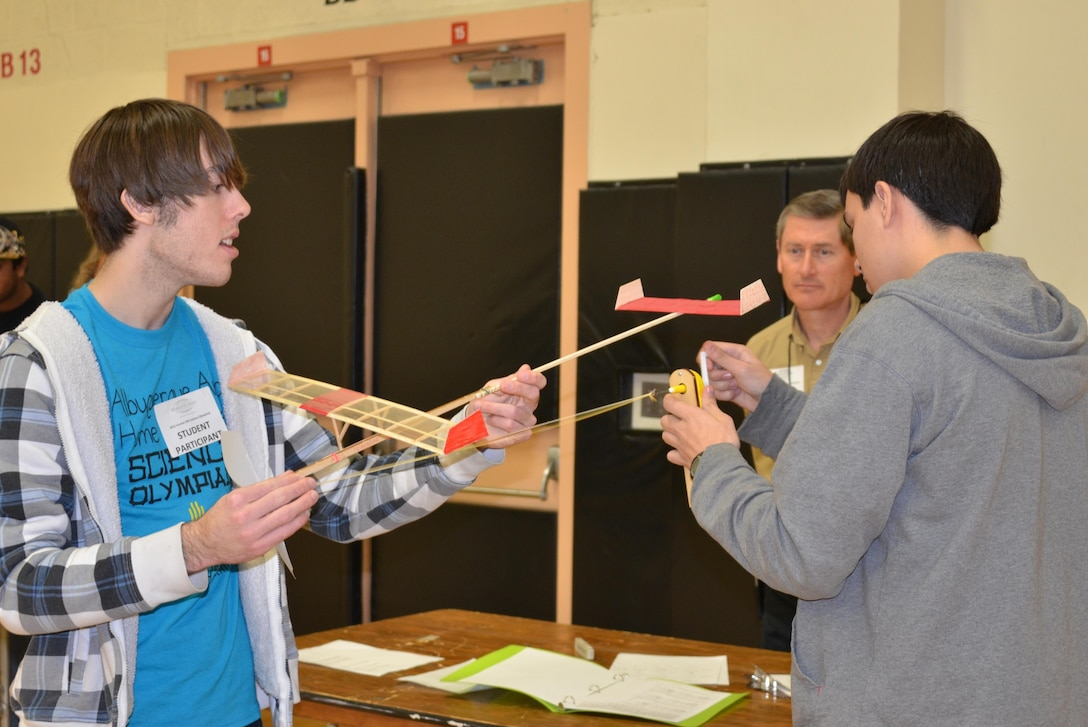 "ALBUQUERQUE, N.M., -- Two students prepare their plane prior to launching it during ""The Wright Stuff"" event of the 2015 Central New Mexico Regional Science Olympiad, Jan. 31."