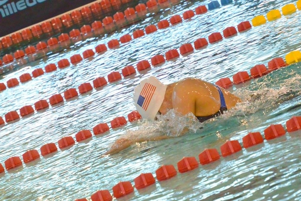 Army Sgt. Elizabeth Wasil (Ft. Carson, Colo.) races to the finish during her gold medal performance in the 100m breaststroke in the CISM ISC para-swimming classification during the 2015 Conseil International du Sport Militaire (CISM) Swimming & Para-Swimming Open.