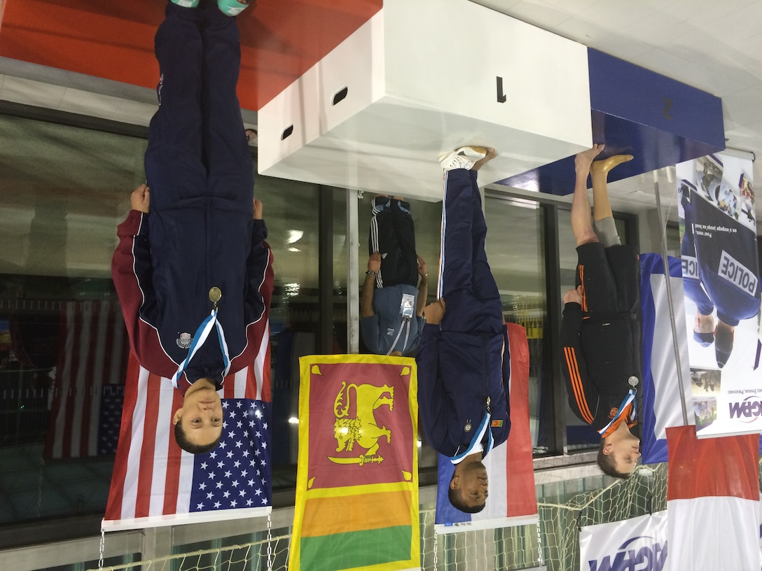 Army Sgt. Elizabeth Wasil (Ft. Carson, Colo.) stands on the podium after being awarded the bronze medal in the 50m backstroke in the CISM ISC para-swimming classification during the 2015 Conseil International du Sport Militaire (CISM) Swimming & Para-Swimming Open.