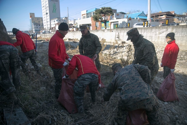 Republic of Korea and U.S. Marines pick up trash during Korean Marine Exchange Program 15-17 Feb. 12 in Pohang, ROK. U.S. Marines have a strong belief that, upon leaving somewhere, they must leave it in better condition than when they arrived. Marines with 3rd Battalion, 3rd Marine Regiment decided to put this belief into action. The overarching goal of KMEP is to enhance and improve the interoperability of ROK and U.S. Marine Corps forces. The ROK Marines are with the 1st Engineer Battalion, 1st ROK Marine Division. The U.S. Marines are 3rd Battalion, 3rd Marine Regiment, currently assigned to 4th Marine Regiment, 3rd Marine Division, III Marine Expeditionary Force under the unit deployment program.