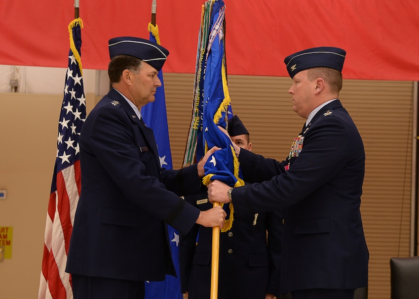 U.S. Air Force Lt. Gen. Bradley Heithold, Commander Air Force Special Operations Command, accepts the relinquishment of command from Col. Tony Bauernfeind, outgoing 27th Special Operations Wing commander, Feb. 17, 2015 at Cannon Air Force Base, N.M.  Bauernfeind was recognized for creating a first-class environment for Air Commandos and their families to thrive while leading the U.S. Air Force's most relevant wing.  (U.S. Air Force photo/Airman 1st Class Chip Slack)