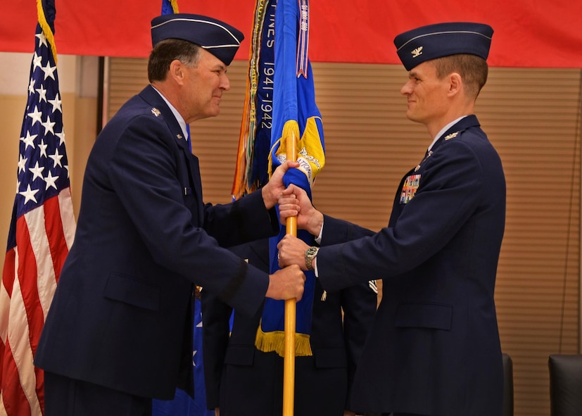 U.S. Air Force Lt. Gen. Bradley Heithold, Commander Air Force Special Operations Command, presents the guidon, representing assumption of command, to Col. Benjamin Maitre, incoming 27th SOW commander, Feb. 17, 2015 at Cannon Air Force Base, N.M. Heithold presided over the ceremony where he conveyed directly to Air Commandos his appreciation for the outstanding, sustained efforts by Team Cannon. (U.S. Air Force photo/Airman 1st Class Chip Slack)