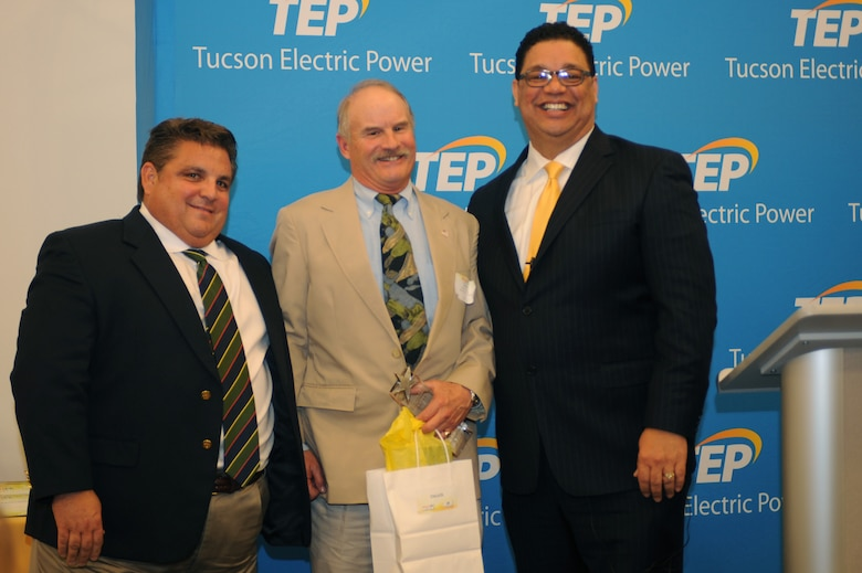 Greg Noble, 355th Civil Engineering Squadron base energy manager, accepts an award on behalf of Davis-Monthan Air Force Base, Ariz., at Tucson Electric Power Feb. 11, 2015. D-M received the Bright Energy Efficiency award for reducing their energy use and lowering monthly electric bills by adopting significant energy efficiency measures. (U.S. Air Force photo by Airman 1st Class Cheyenne Morigeau/Released)