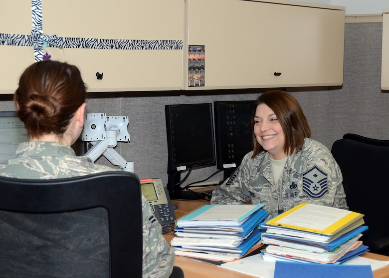 Master Sgt. Kirsten Inwood, a First Sergeant with the Missouri Air National Guard's 131st Bomb Wing Medical Group, mentors a Citizen Airmen at Whiteman Air Force Base, Missouri, Feb. 11, 2015.   She is the Missouri Air National Guard's 2014 First Sergeant of the Year. (U.S. Air National Guard photo by Senior Master Sgt. Mary-Dale Amison)