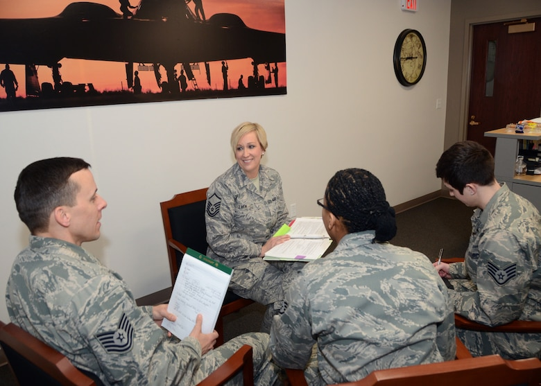 Master Sgt. Melissa Lakin, the recruiter supervisor for the Missouri Air National Guard's 131st Bomb Wing, meets with her recruiting staff at Whiteman Air Force Base, Missouri, Feb. 10, 2015.   She is the Missouri Air National Guard's 2014 Senior Non Commissioned Officer of the Year.  (U.S. Air National Guard photo by Senior Master Sgt. Mary-Dale Amison)