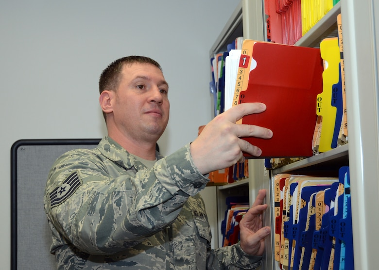 Tech. Sgt. Matthew Storm, a public health craftsman with the Missouri Air National Guard's 131st Bomb Wing Medical Group, examines Citizen Airmen's medical records at Whiteman Air Force Base, Missouri, Feb. 11, 2015.   He is the Missouri Air National Guard's 2014 Non Commissioned Officer of the Year. (U.S. Air National Guard photo by Senior Master Sgt. Mary-Dale Amison)