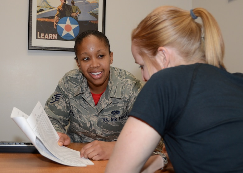 Staff Sgt. Brittany O'Neal, a production recruiter with the Missouri Air National Guard's 131st Bomb Wing, greets a potential recruit at Whiteman Air Force Base, Missouri, Feb. 10, 2015.   She is the Missouri Air National Guard's 2014 Airman of the Year. (U.S. Air National Guard photo by Senior Master Sgt. Mary-Dale Amison)