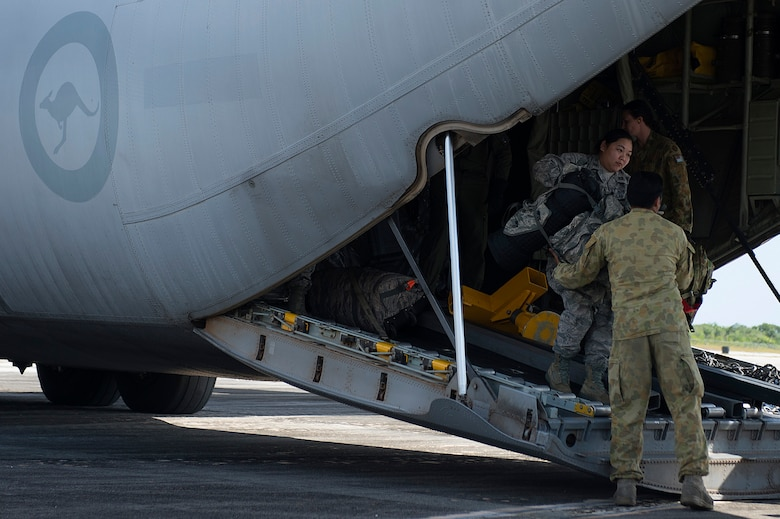 A U.S. Air Force Airman exits a Royal Australian Air Force C-130 Hercules to participate in a humanitarian assistance and disaster relief training event at exercise COPE NORTH 15 at Rota, Northern Mariana Islands, Feb. 15, 2015. Exercise CN 15 enhances humanitarian assistance and disaster relief crisis response capabilities between six nations and lays the foundation for regional cooperation expansion during real-world contingencies in the Asia-Pacific Region. (U.S. Air Force photo by Tech. Sgt. Jason Robertson/Released)