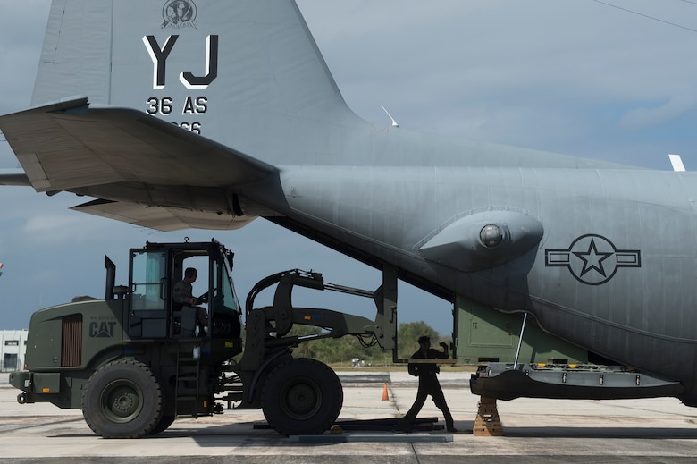 U.S. Air Force Airmen from the 36th Contingency Response Group and the 36th Airlift Squadron, offload a container from a C-130 Hercules during a humanitarian assistance and disaster relief training event at exercise COPE NORTH 15 at Rota, Northern Mariana Islands, Feb. 15, 2015. Exercise CN 15 enhances humanitarian assistance and disaster relief crisis response capabilities between six nations and lays the foundation for regional cooperation expansion during real-world contingencies in the Asia-Pacific Region. (U.S. Air Force photo by Tech. Sgt. Jason Robertson/Released)