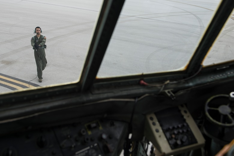 U.S. Air Force Staff Sgt. Gary Patterson, 36th Airlift Squadron C-130 Hercules loadmaster, communicates with pilots during engine startup procedures before taking off on a humanitarian assistance and disaster relief training event at exercise COPE NORTH 15 at Anderson Air Force Base, Guam, Feb. 15, 2015. Exercise CN 15 enhances humanitarian assistance and disaster relief crisis response capabilities between six nations and lays the foundation for regional cooperation expansion during real-world contingencies in the Asia-Pacific Region. (U.S. Air Force photo by Tech. Sgt. Jason Robertson/Released)
