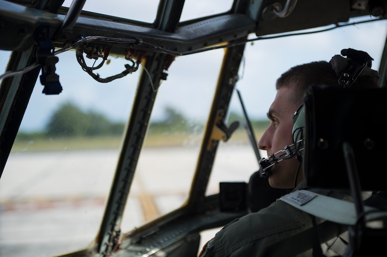 U.S. Air Force Capt. Ian Haig, 36th Airlift Squadron C-130 Hercules pilot, prepares to take off from Rota, Northern Mariana Islands, after delivering cargo used in a humanitarian assistance and disaster relief training event at exercise COPE NORTH 15 at Anderson Air Force Base, Guam, Feb. 15, 2015. Exercise CN 15 enhances humanitarian assistance and disaster relief crisis response capabilities between six nations and lays the foundation for regional cooperation expansion during real-world contingencies in the Asia-Pacific Region. (U.S. Air Force photo by Tech. Sgt. Jason Robertson/Released)