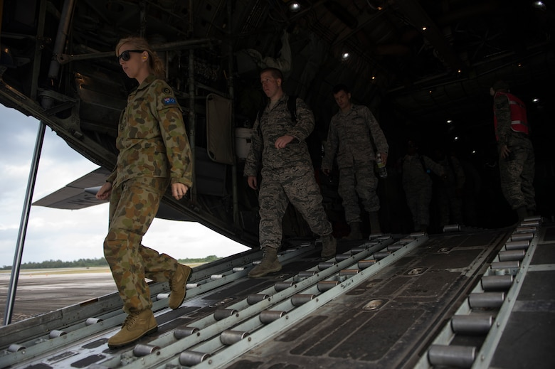 U.S. Air Force and Royal Australian Air Force Airmen walk off the ramp of a C-130 Hercules aircraft while participating in a humanitarian assistance and disaster relief training event at exercise COPE NORTH 15 at Rota at Northern Mariana Islands, Feb. 15, 2015. Exercise CN 15 enhances humanitarian assistance and disaster relief crisis response capabilities between six nations and lays the foundation for regional cooperation expansion during real-world contingencies in the Asia-Pacific Region. (U.S. Air Force photo by Tech. Sgt. Jason Robertson/Released)