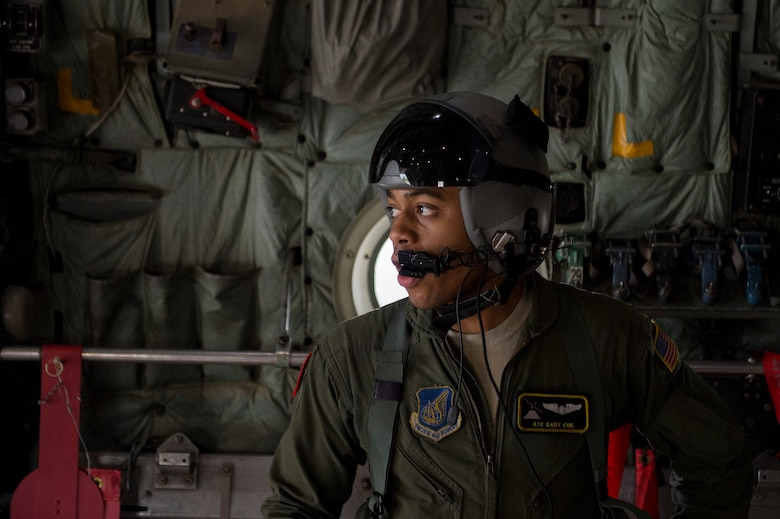 U.S. Air Force Senior Airman Gary Coe, 36th Airlift Squadron C-130 Hercules loadmaster, monitors the off load of cargo used during a humanitarian assistance and disaster relief training event at exercise COPE NORTH 15 at Rota, Northern Mariana Islands, Feb. 15, 2015. Exercise CN 15 enhances humanitarian assistance and disaster relief crisis response capabilities between six nations and lays the foundation for regional cooperation expansion during real-world contingencies in the Asia-Pacific Region. (U.S. Air Force photo by Tech. Sgt. Jason Robertson/Released)