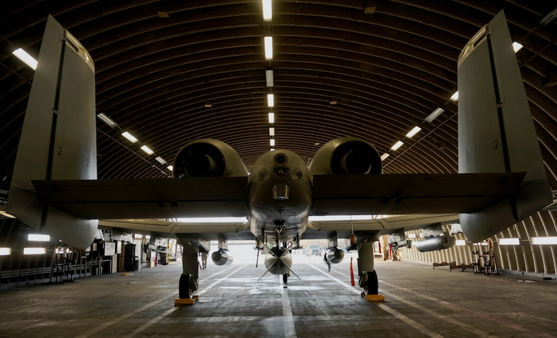 An A-10 Thunderbolt II aircraft assigned to the 354th Expeditionary Fighter Squadron sits inside a hardened aircraft shelter at Spangdahlem Air Base, Germany, Feb. 13, 2015. The A-10s deployed as part of a theater security package in support of Operation Atlantic Resolve. The Air Force has been conducting similar TSP rotations in the Pacific region since 2004. (U.S. Air Force photo by Airman 1st Class Timothy Kim/Released)