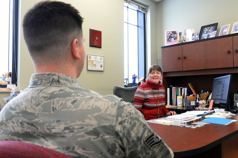New Hampshire Air National Guard Airman and Family Readiness Program Manager, Mrs. Bonnie Rice, speaks to Staff Sgt. Curtis J. White on Feb. 8, 2015 at Pease Air National Guard Base, N.H. The 157th Air Refueling Wing is one of seven reserve component units to be recognized during the 2014 Department of Defense Reserve Family Readiness Awards Ceremony to be held Feb. 27, at the Pentagon. (U.S. Air National Guard photo by Staff Sgt. Curtis J. Lenz)