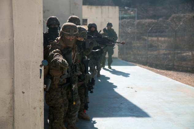 U.S. Marine Lance Cpl. Danny E. McClure, from Decatur, Illinois, throws an M69 training grenade during Korean Marine Exchange Program 15-17 Feb. 9 at the Cham Sae Mi Close-Quarters Training Facility in Pohang, Republic of Korea. The overarching goal of KMEP is to enhance and improve the interoperability of ROK and U.S. Marine Corps forces. McClure is a rifleman with Company I, 3rd Battalion, 3rd Marine Regiment, currently assigned to 4th Marine Regiment, 3rd Marine Division, III Marine Expeditionary Force under the unit deployment program.