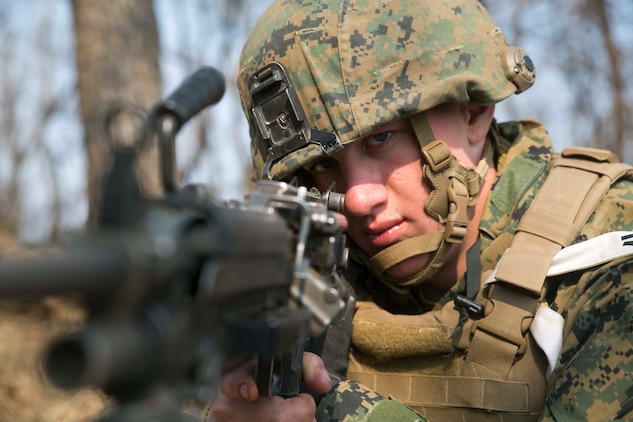 U.S. Marine Lance Cpl. Nick A. Foss, from Lakeville, Minnesota, looks down the sights of his M249 squad automatic weapon during Korean Marine Exchange Program 15-17 Feb. 10 at the Cham Sae Mi Close-Quarters Battle Training Facility in Pohang, Republic of Korea. KMEP 15-17 is just one iteration in a series of continuous bilateral training exercises that enhance the ROK and U.S. alliance, promote stability on the Korean Peninsula and strengthen ROK and U.S. military capabilities and interoperability. Foss is a machine gunner with Company I, 3rd Battalion, 3rd Marine Regiment, currently assigned to 4th Marine Regiment, 3rd Marine Division, III Marine Expeditionary Force under the unit deployment program.