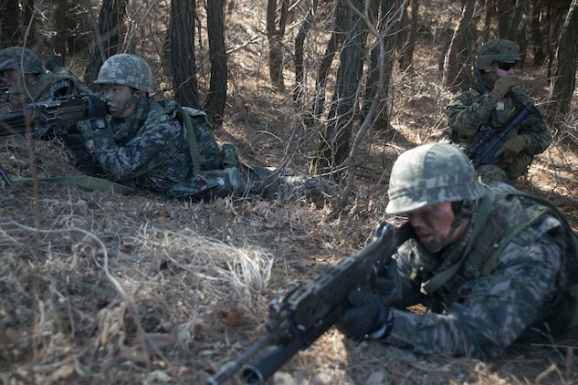 Republic of Korea and U.S. Marines assault enemy defensive positions during Korean Marine Exchange Program 15-17 Feb. 13 at the Cham Sae Mi Close-Quarters Battle Training Facility in Pohang, Republic of Korea. The overarching goal of KMEP is to enhance and improve the interoperability of ROK and U.S. Marine Corps forces. The ROK Marines are with Company 6, 32nd Battalion, 1st ROK Marine Division. The U.S. Marines are with Company K, 3rd Battalion, 3rd Marine Regiment, currently assigned to 4th Marine Regiment, 3rd Marine Division, III Marine Expeditionary Force under the unit deployment program.