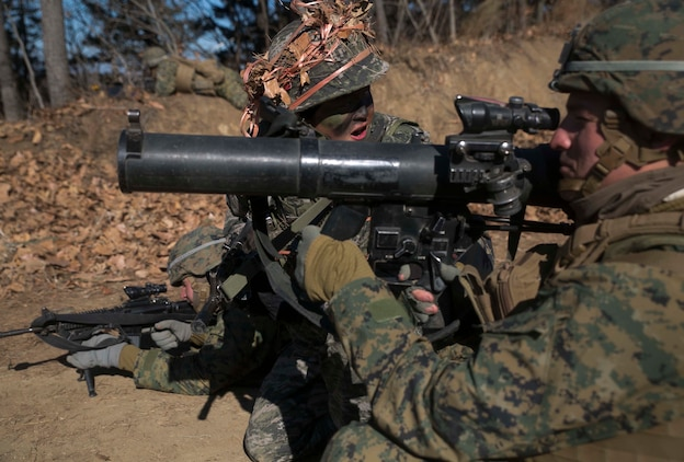 Republic of Korea and U.S. Marines prepare to fire a shoulder-launched multipurpose assault weapon during Korean Marine Exchange Program 15-17 Feb. 13 at the Cham Sae Mi Close-Quarters Battle Training Facility in Pohang, Republic of Korea. The SMAW is a shoulder-launched rocket weapon with the primary function of being a portable assault weapon and a secondary anti-armor rocket launcher. From planning to execution, KMEP 15-17 has been a bilateral and collaborative effort between ROK and U.S. Marine Corps forces. The ROK Marines are with Company 5, 32nd Battalion, 1st ROK Marine Division. The U.S. Marines are with Company I, 3rd Battalion, 3rd Marine Regiment, currently assigned to 4th Marine Regiment, 3rd Marine Division, III Marine Expeditionary Force under the unit deployment program.