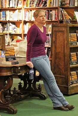 Capt. Cara J. Swanson, an Individual Mobilization Augmentee, discusses her recently published novel, The Long Journey, Tales from a World Yet to Come, at Denver-area bookstore Jan. 27. The science fiction novel won second place in the 2014 Kindle Awards Best Fiction category.
