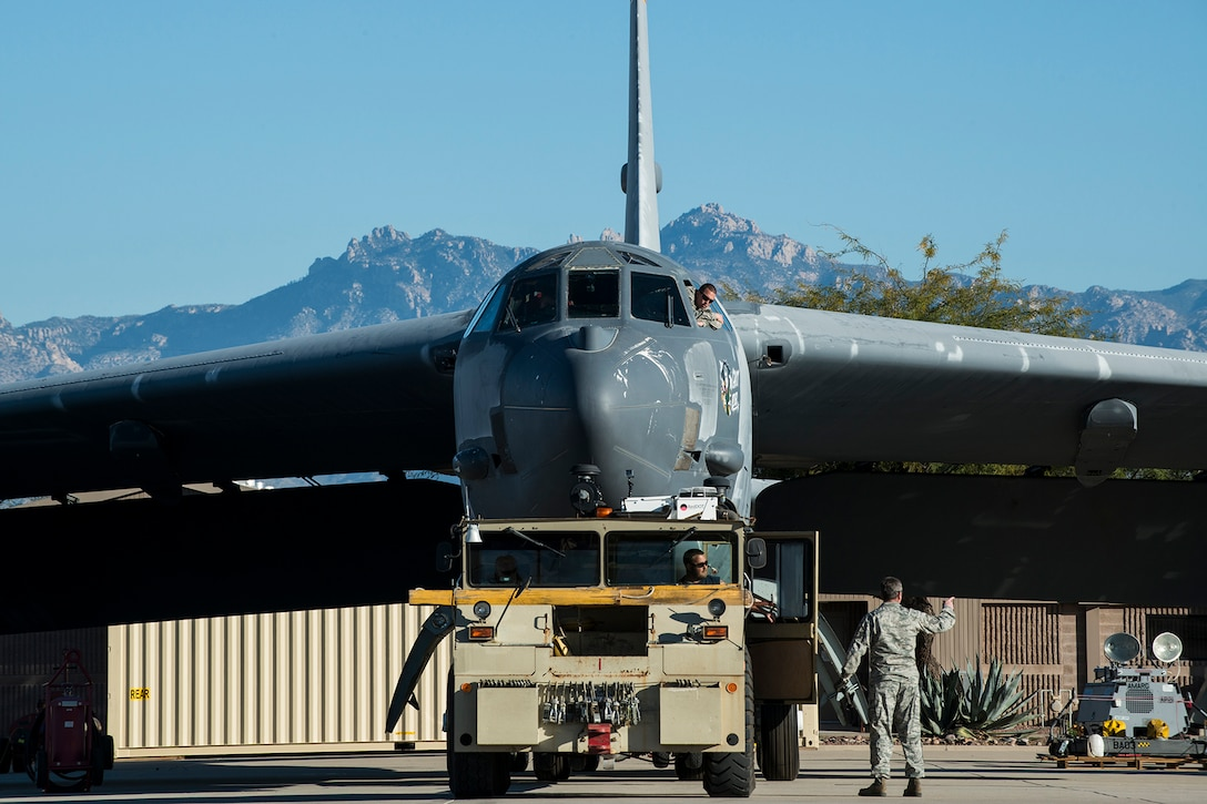 """A U.S. Air Force B-52 Stratofortress is towed from a maintenance area at the 309th Aerospace Maintenance and Regeneration Group, Feb. 11, 2015, Davis-Monthan Air Force Base, Ariz. The aircraft, tail number 61-1007 and known as the """"Ghost Rider"""", is being regenerated for active servie after sitting in storage since 2008 when it was decommssioned and sent the Boneyard. (U.S. Air Force photo by Master Sgt. Greg Steele/Released)"""