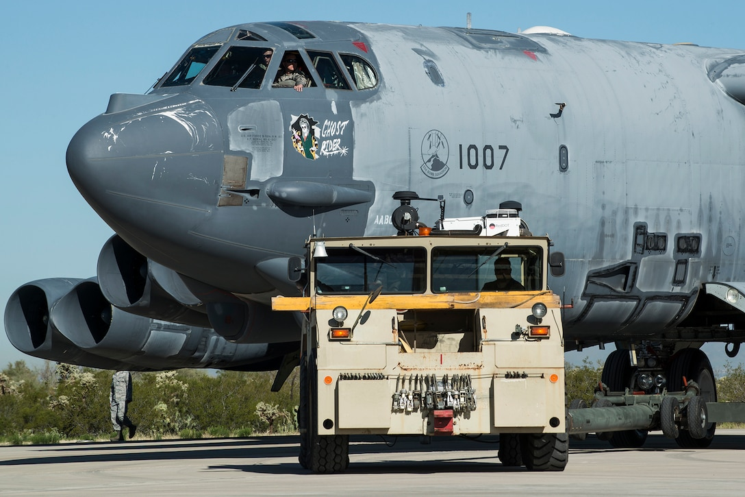 """A U.S. Air Force B-52 Stratofortress is towed from a maintenance area at the 309th Aerospace Maintenance and Regeneration Group, Feb. 11, 2015, Davis-Monthan Air Force Base, Ariz. The aircraft, tail number 61-1007 and known as the """"Ghost Rider"""", is being regenerated for active service after sitting in storage since 2008 when it was decommissioned and sent the Boneyard. (U.S. Air Force photo by Master Sgt. Greg Steele/Released)"""