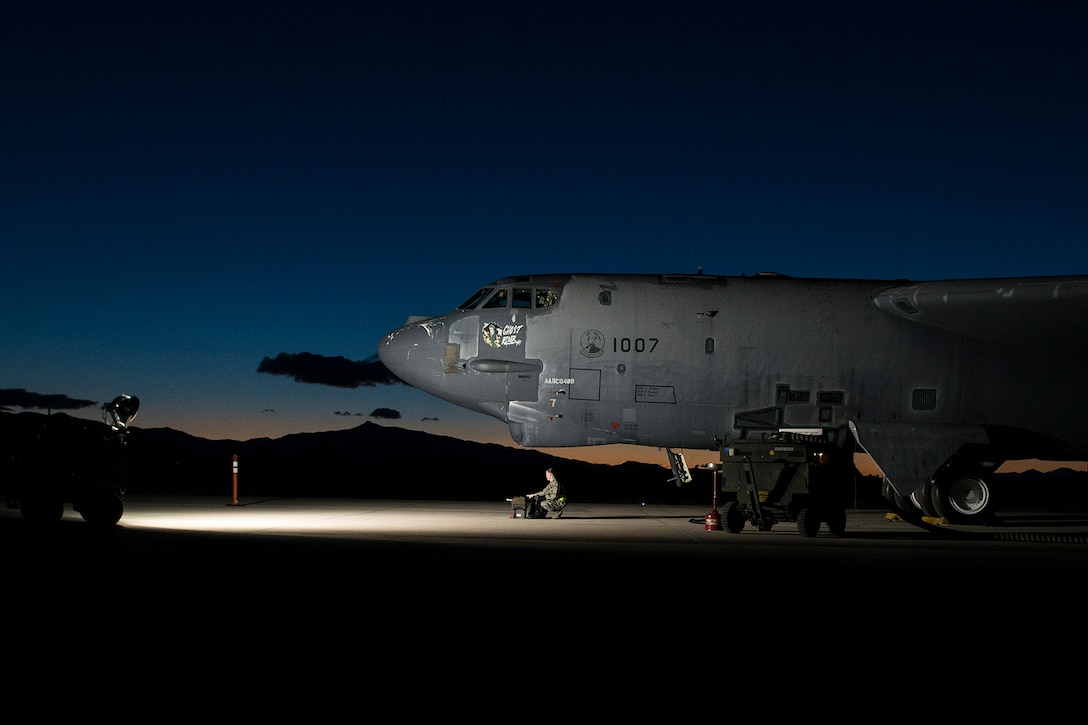 """The sun rises behind the """"Ghost Rider"""" as it is prepared for an early morning taxi test on Feb. 12, 2015, Davis-Monthan Air Force Base, Ariz. The B-52H Stratofortress was decommissioned in 2008 and has been sitting in the 309th Aerospace Maintenance and Regeneration Group's """"Boneyard"""", but is being restored to join the active fleet of B-52s. (U.S. Air Force photo by Master Sgt. Greg Steele/Released)"""