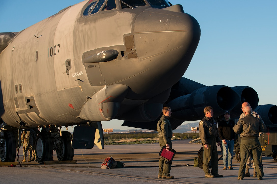 """Aircrew arrive to perform a taxi test on a B-52H Stratofortress, Feb. 12, 2015, Davis-Monthan Air Force Base, Ariz. The aircraft, known as the """"Ghost Rider"""", was decommissioned in 2008 and has been sitting in storage at the 309th Aerospace Maintenance and Regeneration Group's """"Boneyard"""". (U.S. Air Force photo by Master Sgt. Greg Steele/Release)"""